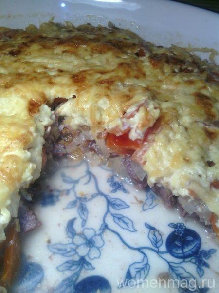 Говядина в молочном соусе с помидорами и сыром в духовке